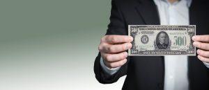 how to make money affilaite marketing : dollar in hand