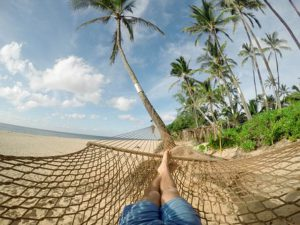 lying in a hammock on the seashore